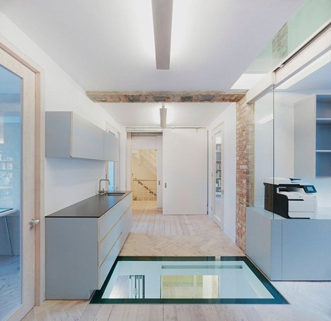Edwardian townhouse renovation by Studio Octopi features windows in the floors
