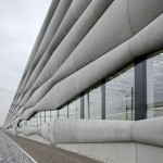 Bulging cement panels clad Zurich railway service facility by EM2N