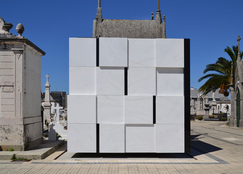 Family mausoleum built from white marble and black glass