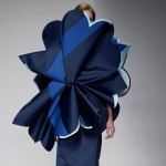 Giant flowers obscure models in Ondrej Adamek's graduate fashion collection
