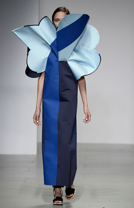 Giant flowers in Ondrej Adamek's graduate fashion collection obscure models