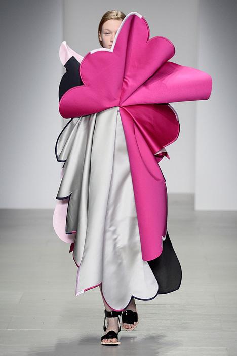 Giant flowers in Ondrej Adamek's graduate fashion collection obscure models