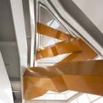 Grand orange staircase ascends through science faculty by Saucier + Perrotte