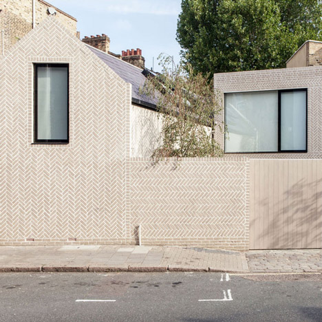 Patterned brickwork surrounds<br /> Atelier ChanChan's Herringbone House