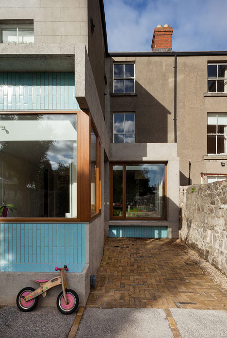 House extension by GKMP Architects includes a wooden window seat