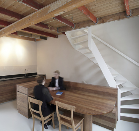 Unknown Architects updates 200-year-old house with twisting staircase and wooden furniture