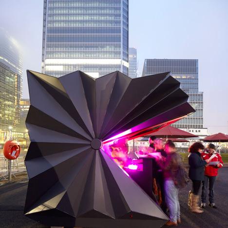 Folded metal kiosks by Make open like a paper fan