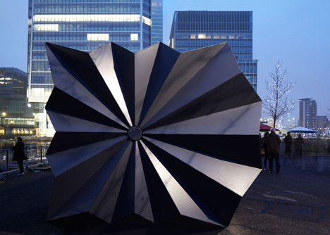 Folded metal kiosks by Make open like a paper fan