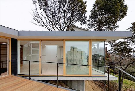 Krampon house by Shogo Aratani climbs over a rocky site