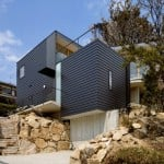 Krampon house by Shogo Aratani climbs over a rocky site