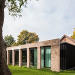 Brick colonnade screens renovated hunting lodge by DMOA Architecten