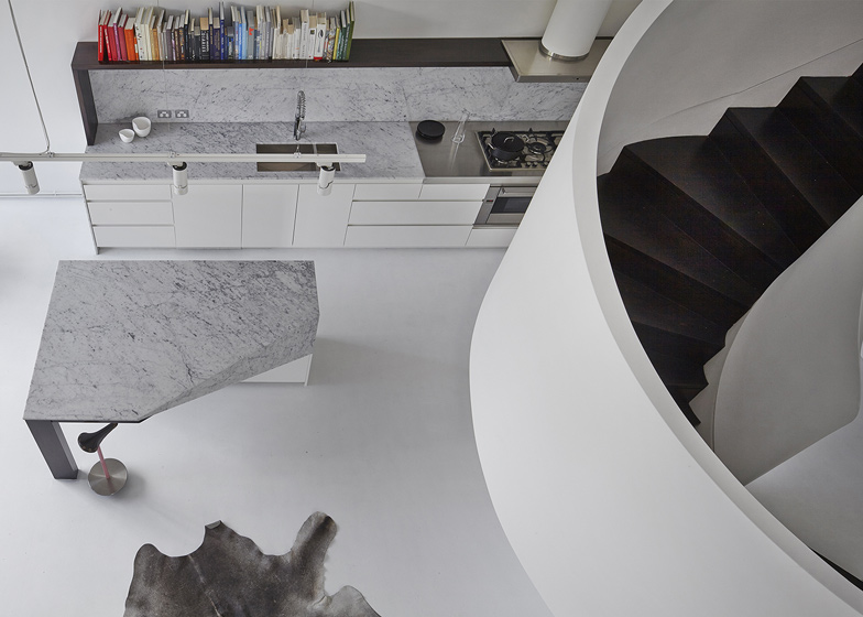 Sculptural staircase twists through loft apartment in Melbourne by Adrian Amore Architects