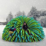 Shelters resembling giant pompoms by RAW Design warm skaters on a frozen river