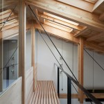 Ninkipen! exposes wooden columns and trusses inside O Pharmacy
