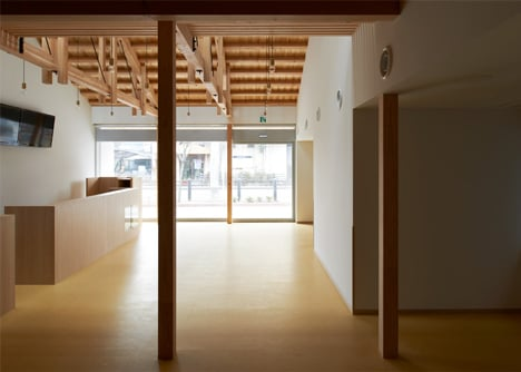 O Pharmacy by Ninkipen! features exposed wooden ceiling