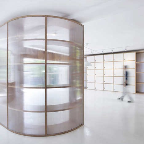 Office renovation featuring polycarbonate and wood par