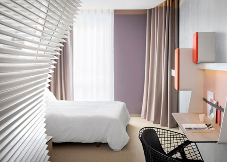 Okko hotel interior by Patrick Norguet with en suites hidden behind louvred walls