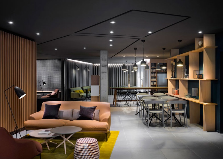 Okko hotel interior by patrick norguet with en suites behind louvred