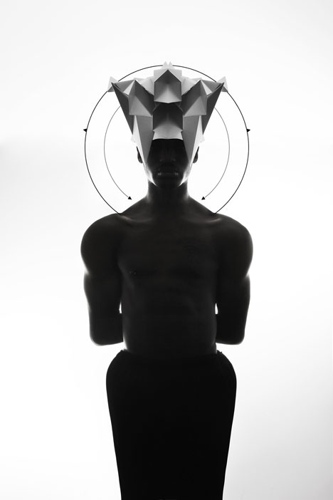 Origami headgear folded to resemble mythological creatures