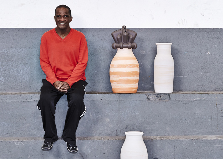 Autistic artist Oswin with some of the pots he has shaped