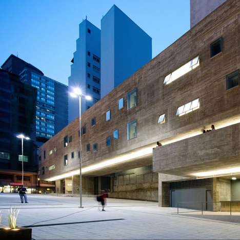 Praça das Artes by Brasil Arquitetura features concrete boxes projecting over a public plaza