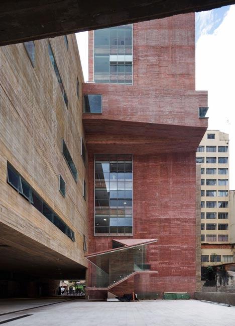 Praca das Artes by Brasil Arquitetura features concrete boxes projecting over a public plaza
