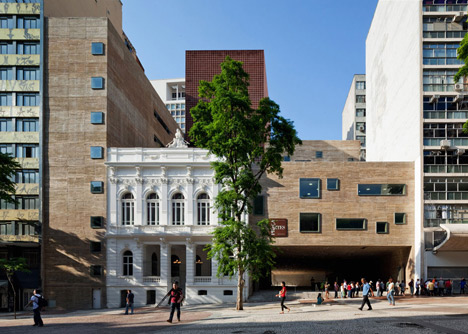 Praca das Artes by Brasil Arquitetura features concrete boxes projecting over a public plaza