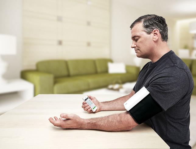 The QardioArm blood pressure monitor in use