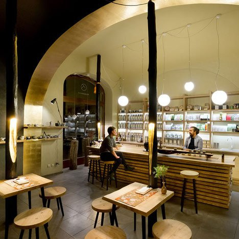 Straw and plaster-lined cafe by A1 Architects based on Japanese tea houses