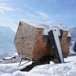 Alpine holiday cabin by Peter Jungmann has metal feet and a beak