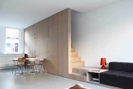8A Architecten renovate house with combined staircase and sofa