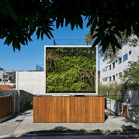 Wall of bushy plants fronts Sao Paulo housing block by TACOA