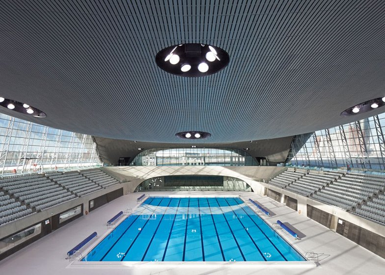for the pool to be swimmable they had to remove 15000 temporary seats at the edges and cover the sides of the pool with windows - Olympic Swimming Pool 2014