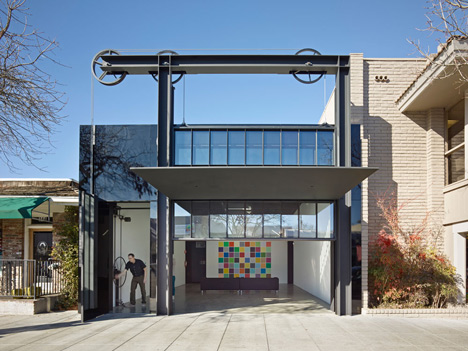 Gears and pulleys are used to lift up the facade of this California gallery