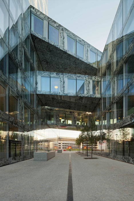 Allianz Headquarters by Wiel Arets features glass fritted to resemble Mies' Barcelona Pavilion