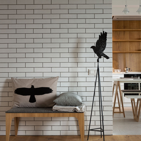 Bird motifs dotted through monochrome Kiev apartment by Olena Yudina