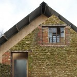 Hugh Strange Architects slots architectural archive inside old farmyard barn