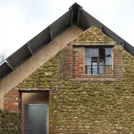 Hugh Strange Architects slots architectural<br /> archive inside old farmyard barn