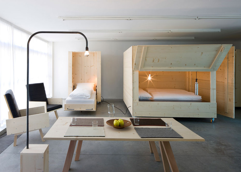 Studio Minimal harry thaler adds mobile furniture and boxy beds to artists' apartment