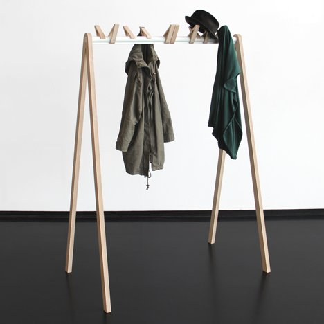 Hooks resembling resting birds perch along coat<br /> rack by Christine Herold and Katharina Ganz