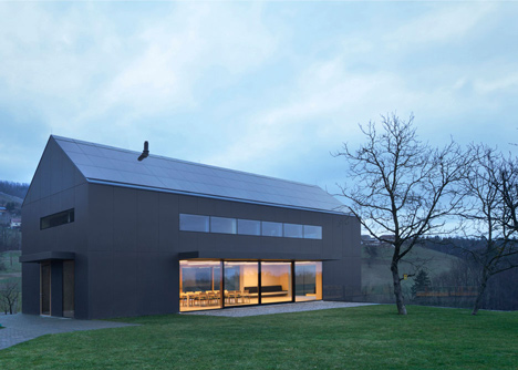 Black Barn by Arhitektura d.o.o. provides panoramic views of the Slovenian countryside