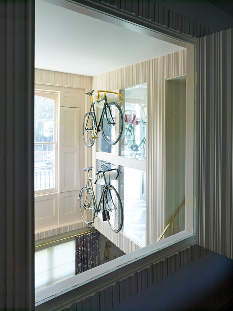 AOC Architecture adds wall-hung bicycles and basket-weave flooring to London townhouse