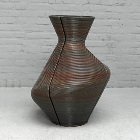 Dirk Vander Kooij uses a robotic arm<br /> to print vases from scrap plastic