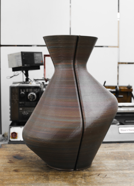 Dirk Vander Kooij uses a robotic arm to print vases from scrap plastic