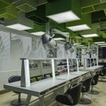 Green boxes pattern the ceiling of Clip Drop In hair salon by Sweco Architects