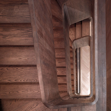 Curvaceous oak staircase ascends through converted convent by John Smart Architects