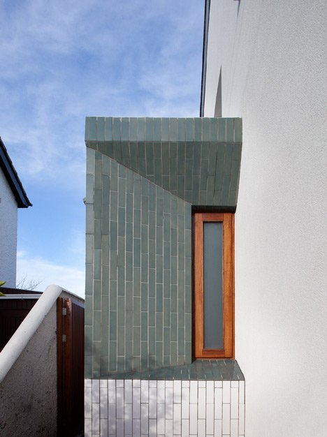 Tile-covered walls reflect light into Greenlea Road extension by GKMP Architects