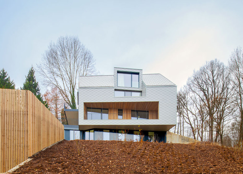 House B.A.B.E. by Destilat features windows dotted across shingle-clad facade