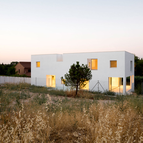 Casa H by Bojaus Arquitectura features a facade covered in holes