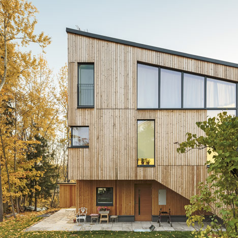 Timber-clad House M-M by Tuomas Siitonen wraps around a sheltered garden